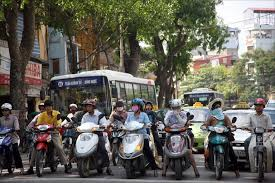 """See here? there are like 7 scooters lined up across in a line. If you are on the far right (in front of the car) and actually need to turn right you are crossing 6 scooters (or """"lanes"""") to do so. That's hell of a lot more than 1 lane."""