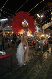 "Saw my first ""ladyboy"" in this night market. This is a really unique part of Thailand's culture. I have not done enough research on this topic to determine if these people are being exploited or not, but they are all over Thailand, and there are shows, etc. Is the concept similar to Drag Queens? I don't know."